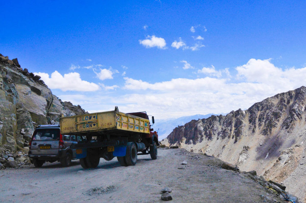 Heavy vehicles driving over Khardung La, the highest road in the world