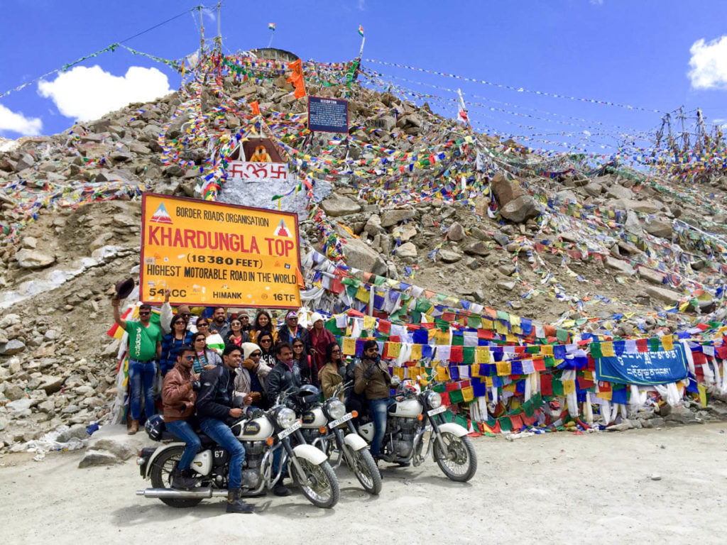 Tourists Indians taking a group picture in the highest road in the world, Khardung La, Ladakh