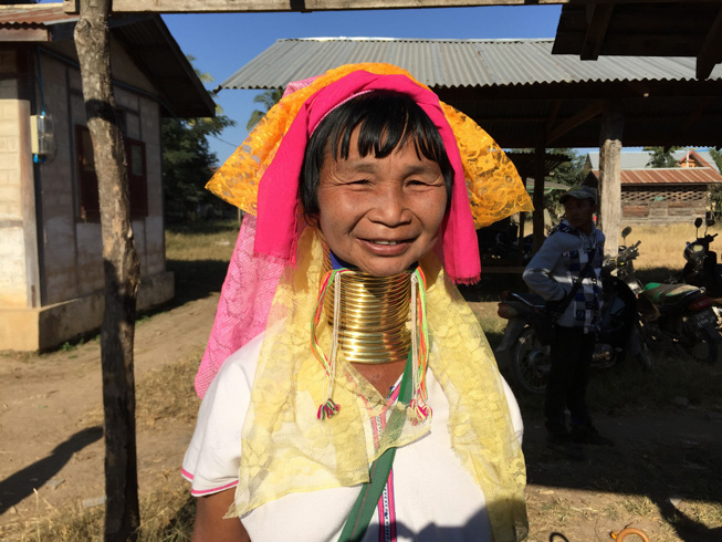 Long neck woman smiling at the camera in Loikaw