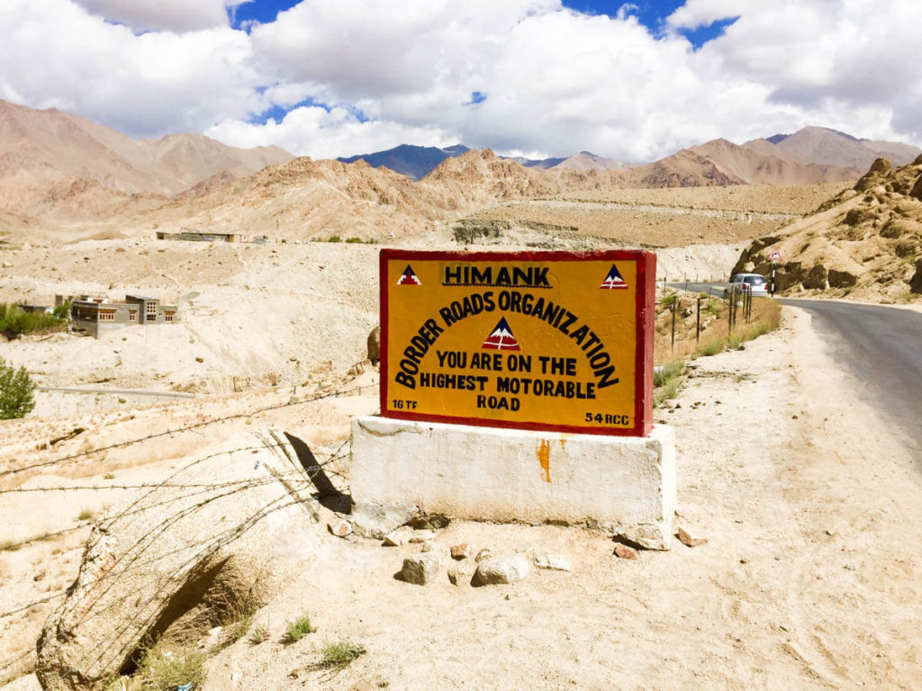Road sign announcing that you are on the highest motorable road in the world