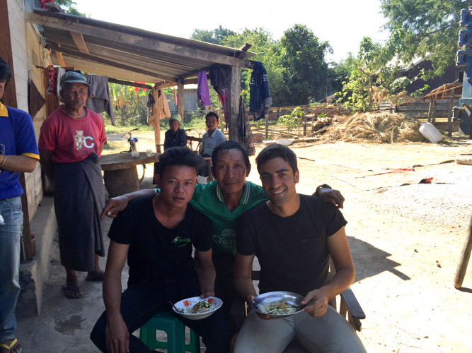 Me sharing a meal with my friend at his place in Loikaw