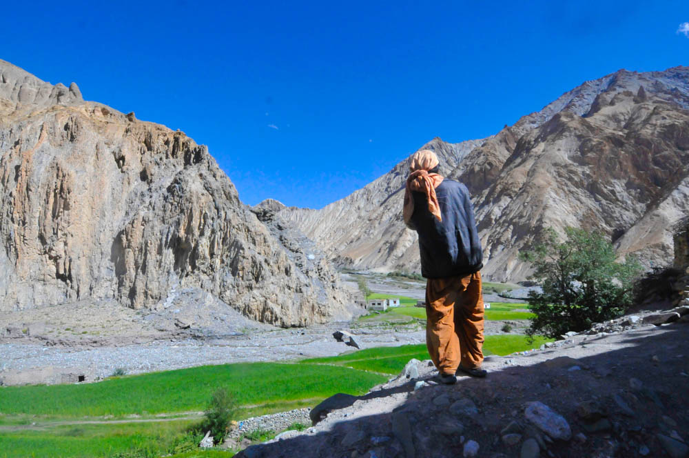 A local Tibetan looking over Markha Village, Ladakh