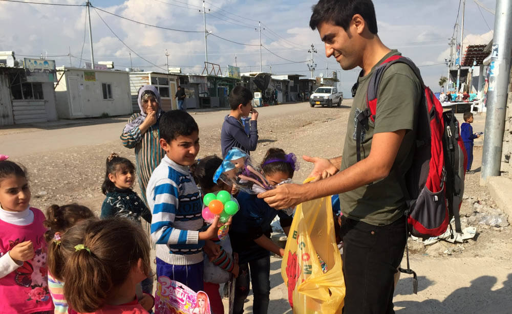 Giving toys to the Syrian children