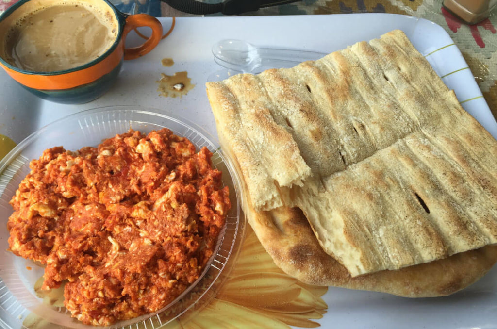 Mirza ghasemi is a traditional Iranian breakfast consisting of eggs, tomato, garlic and smashed eggplant
