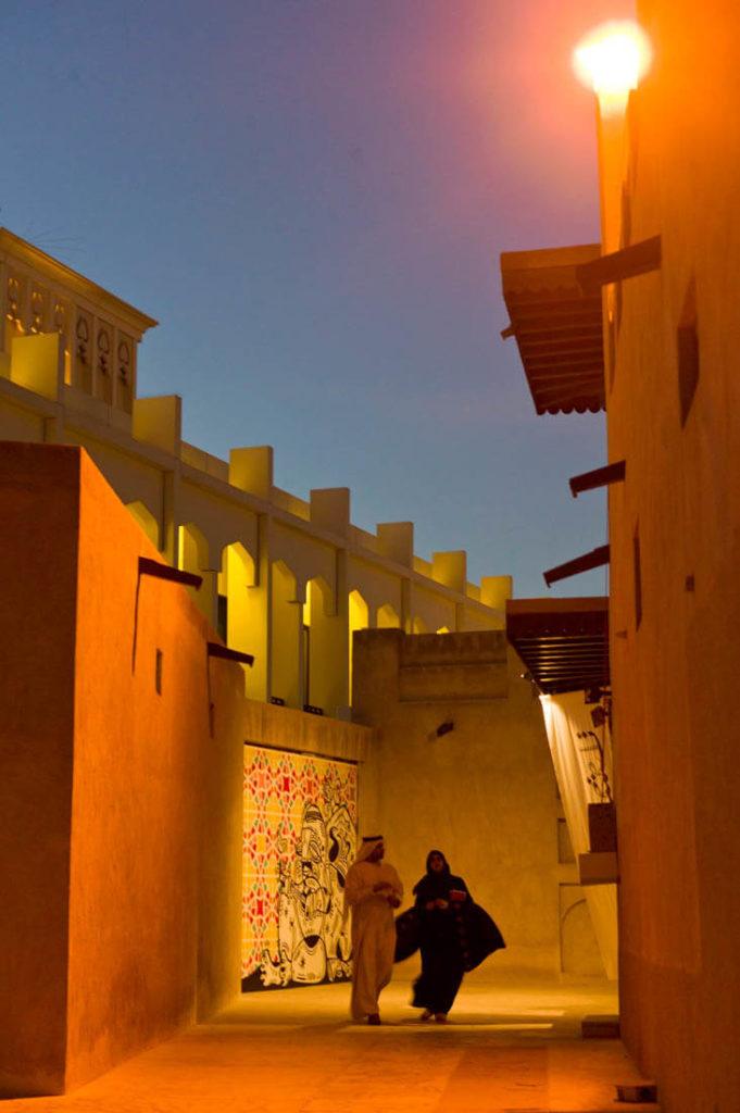 Bastakya and an Emirati couple at night, Dubai