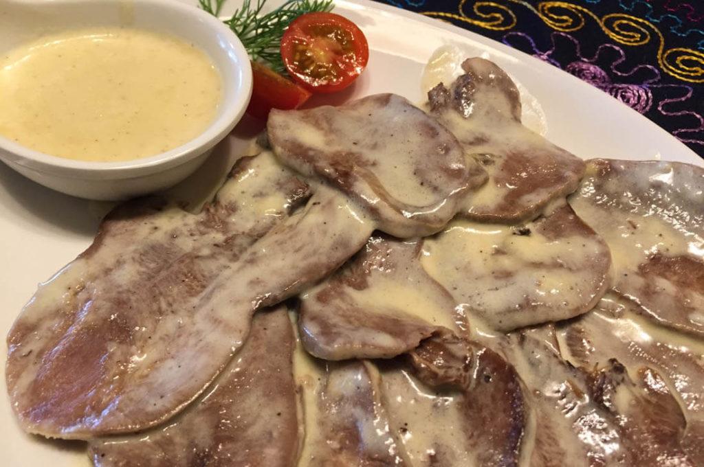 Uzbek Beef tongue, fried in a mild garlic cream sauce