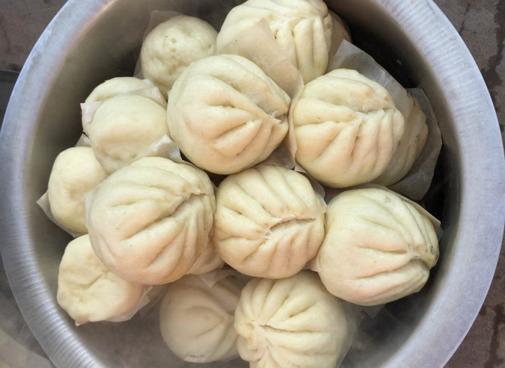 Filled buns with vegetables or meat are another example of Myanmar food with Chinese influence