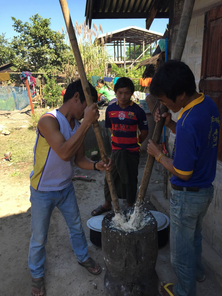 Myanmar people preparing a traditional meal from Kayah State which has a rice paste base