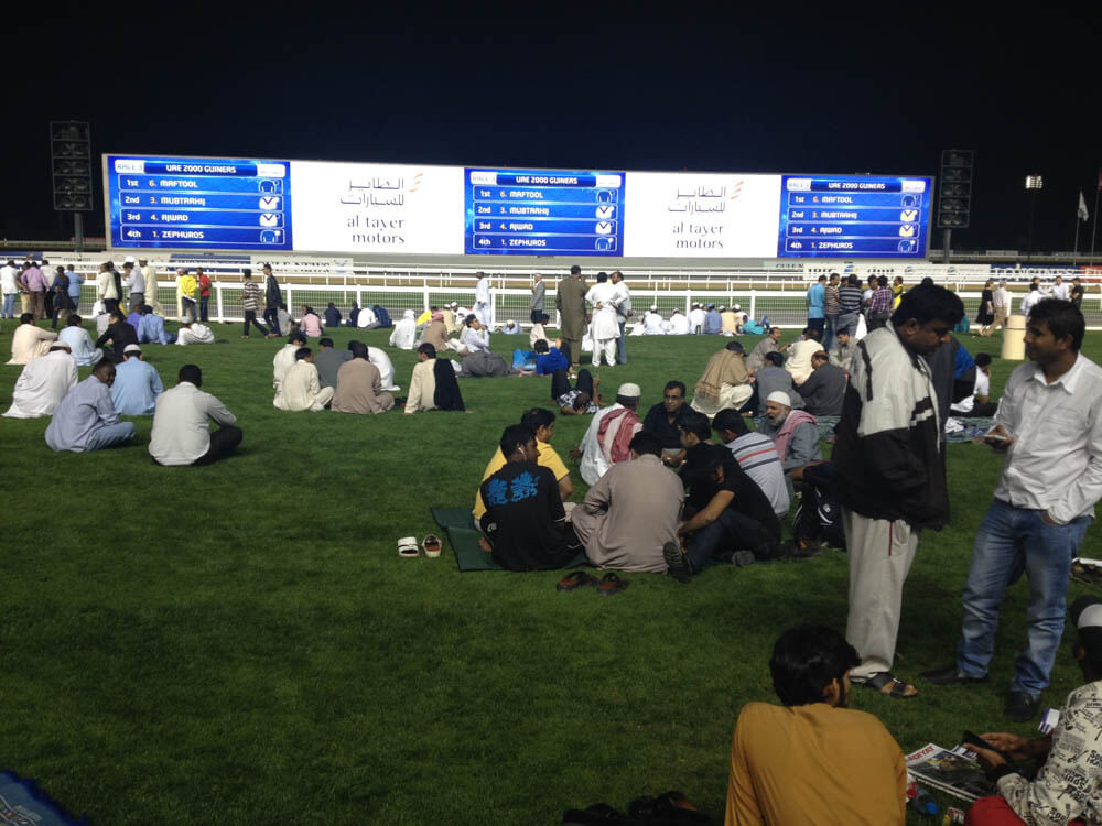 People attending a horse race at the Hotel Meydan in Dubai