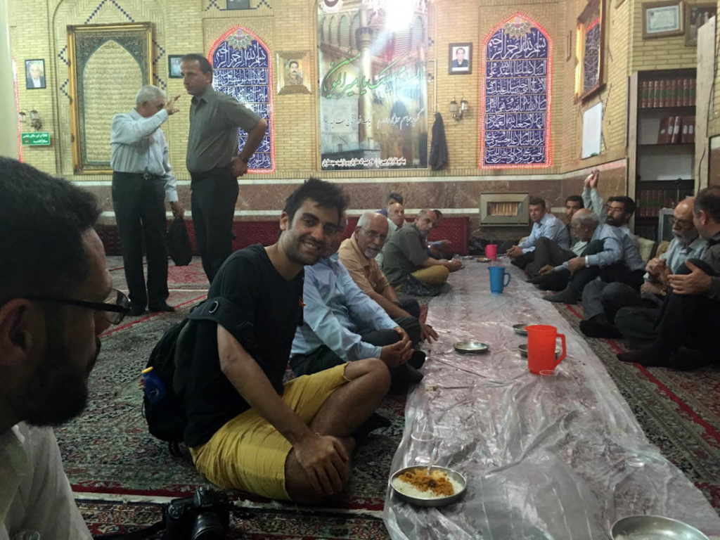 Having dinner at a shia mosque in Shiraz, Iran
