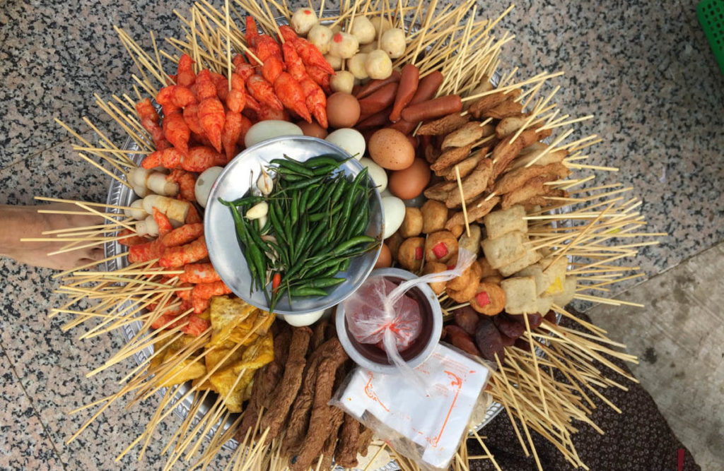 Sea food skewers tray are very common among Yangon street food