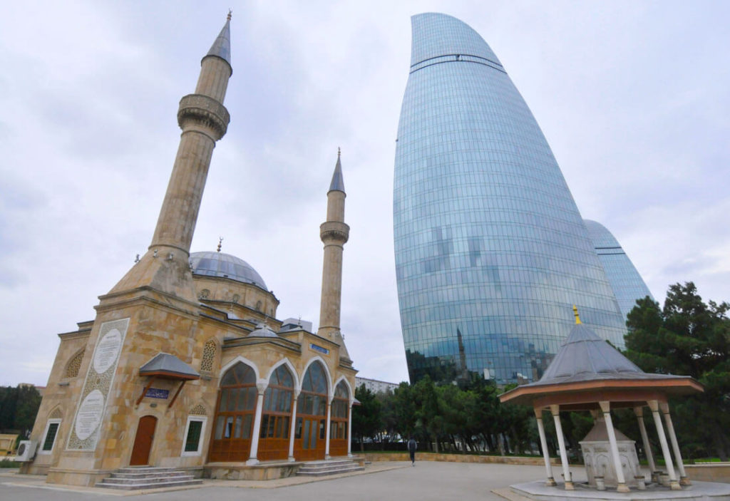 A mosque and the recently built flame towers in Baku