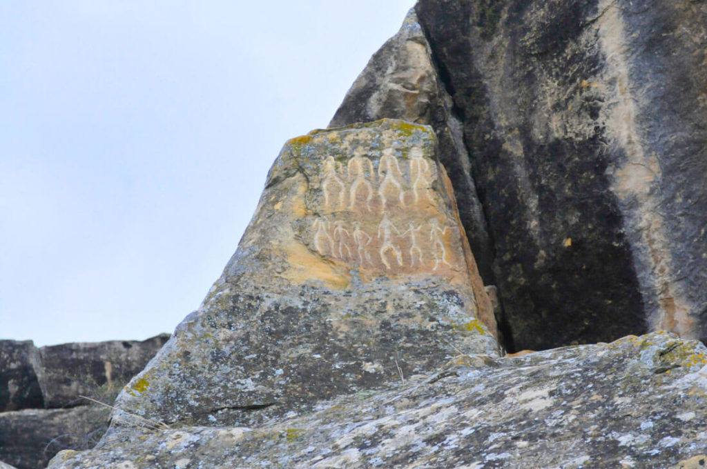 Petroglyph of tribal men dancing in Qobustan, Azerbaijan