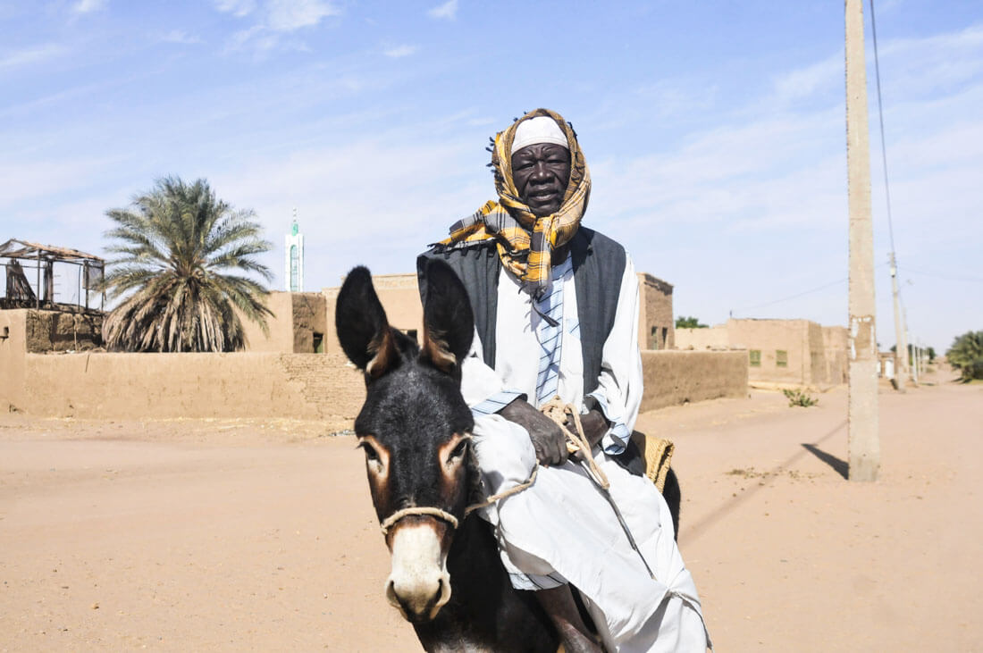 A Nubian man with his donkey