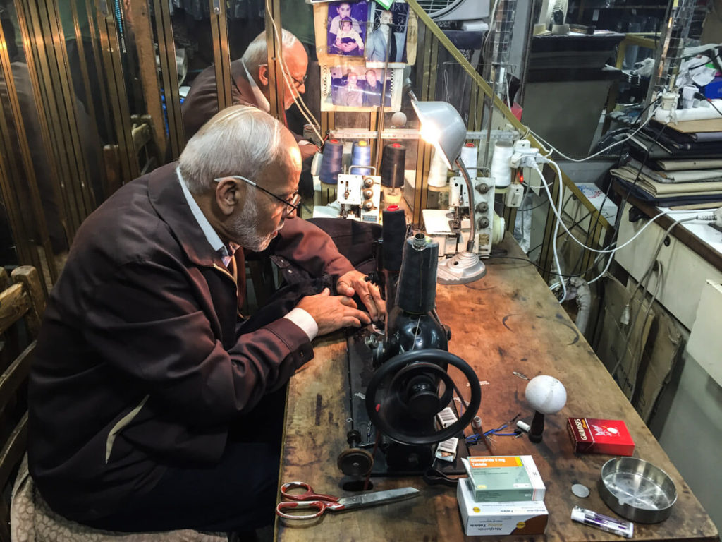 A man sewing my pants in Tripoli, Lebanon