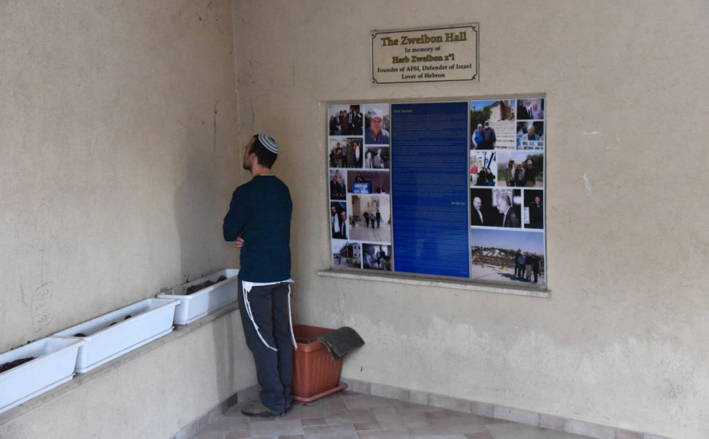 A Jewish praying in the Jewish settlement of Hebron